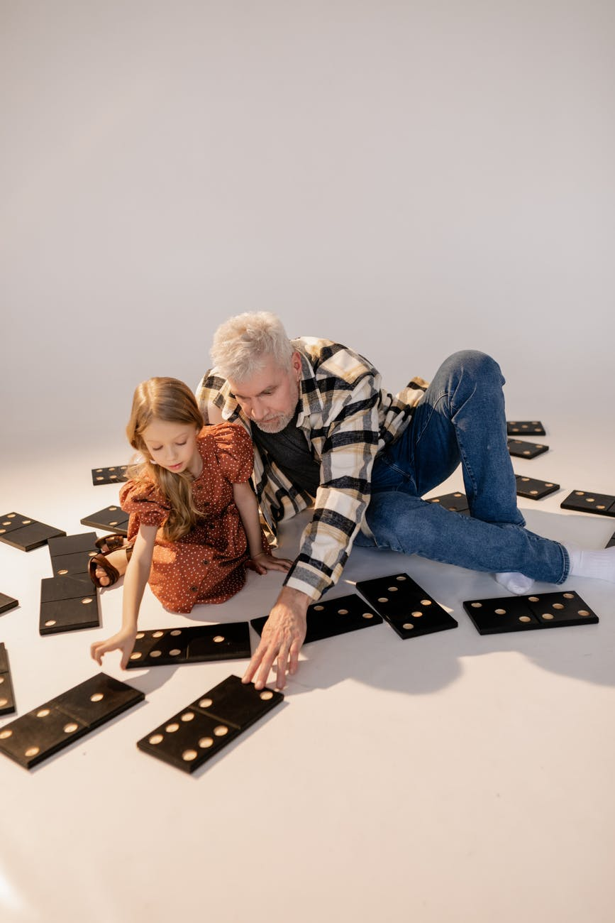 grandfather and granddaughter playing giant lawn dominoes